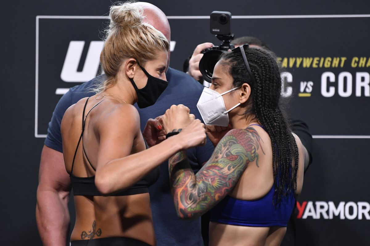 Opponents Ashley Yoder and Livinha Souza of Brazil face off during the UFC 252 weigh-in at UFC APEX on August 14, 2020 in Las Vegas, Nevada.