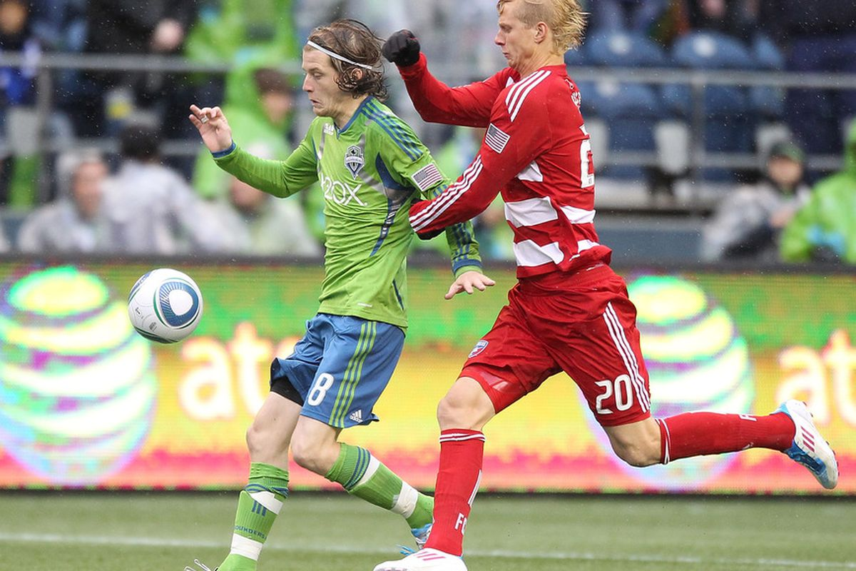 SEATTLE - MAY 25:  Brek Shea #20 of FC Dallas battles Erik Friberg #8 of the Seattle Sounders FC at Qwest Field on May 25, 2011 in Seattle, Washington. (Photo by Otto Greule Jr/Getty Images)