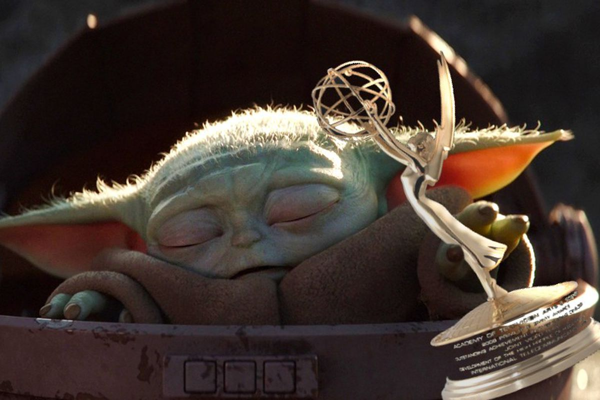 Baby Yoda holding an Emmy statuette