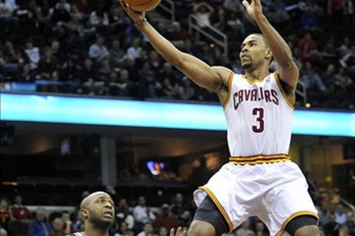 Mar 5, 2012; Cleveland, OH, USA; Cleveland Cavaliers point guard Ramon Sessions (3) scores a layup against Utah Jazz point guard Jamaal Tinsley (6) in the fourth quarter at Quicken Loans Arena. Mandatory Credit: David Richard-US PRESSWIRE