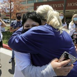 Ana Lucio, who was fighting COVID-19 on a ventilator this time last year, hugs registered nurse Lisa Whittaker, who took care of Lucio in the Lakeview Hospital intensive care unit, after an Alex Boyé concert outside of the Bountifulhospital on Tuesday, May 4, 2021. Lucio was in the hospital for more than two months and was Lakeview's longest COVID-19 admission. She was discharged in May 2020.