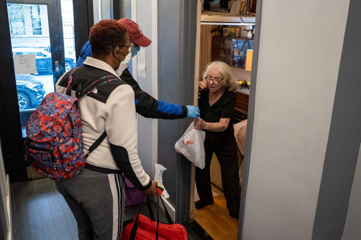 Isaacs Center volunteers deliver a meal.