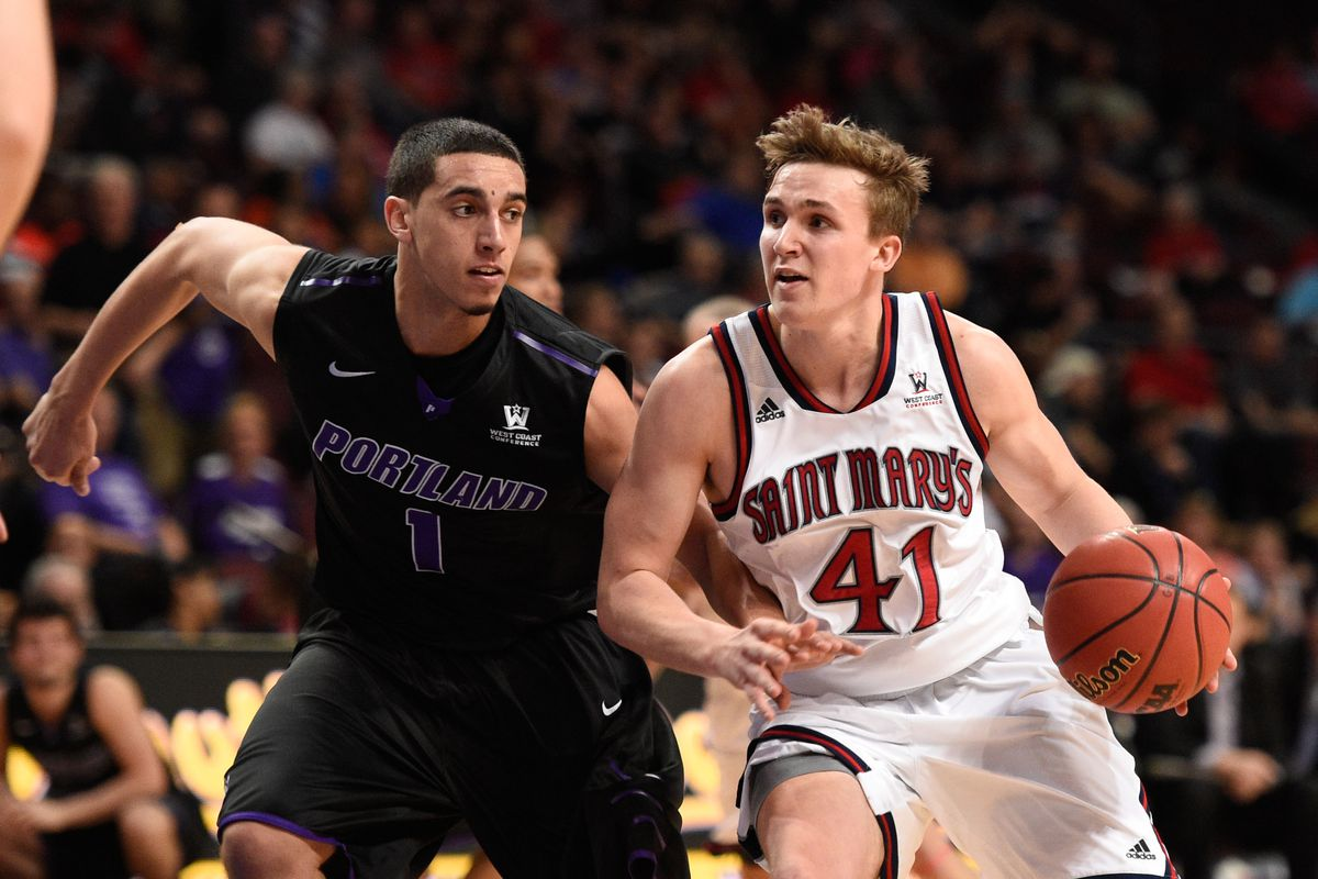 Saint Mary's point guard Emmett Naar drives against Portland's Bryce Pressley during the 2015 WCC Tournament.