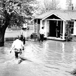 Flooding in the Salt Lake area May 1, 1952.  People leaving their flooded homes.