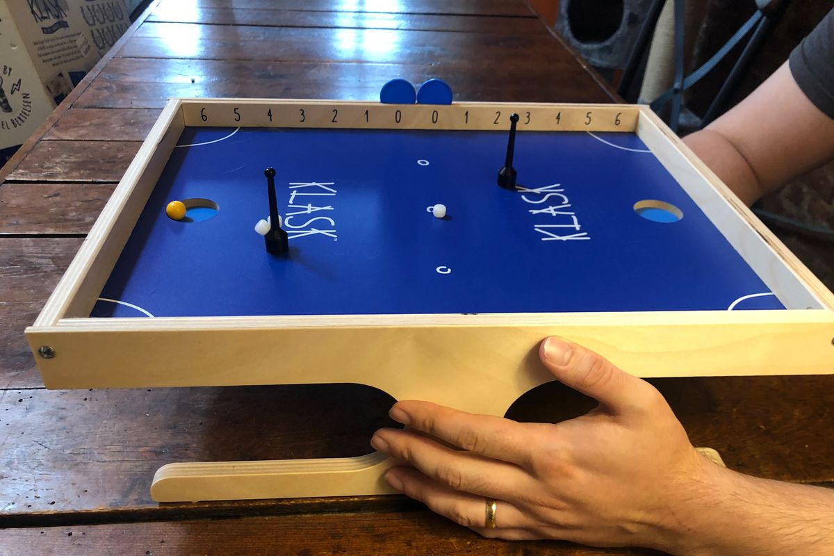 A Klask board with one player
