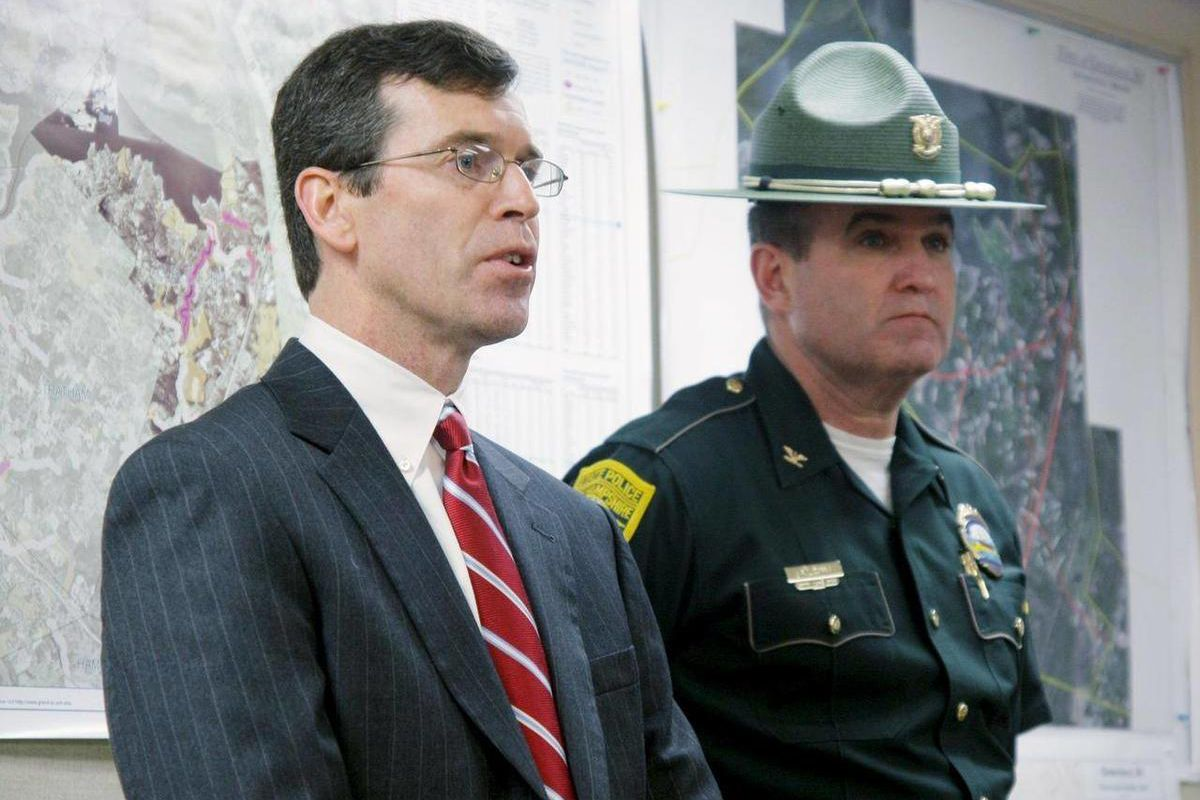 Attorney General Mike Delaney, left, speaks about a standoff in Greenland where a man is alleged to have shot and killed the Greenland police chief and wounded four others. At right is Col. Robert Quinn, director of the State Police Thursday April 12, 201