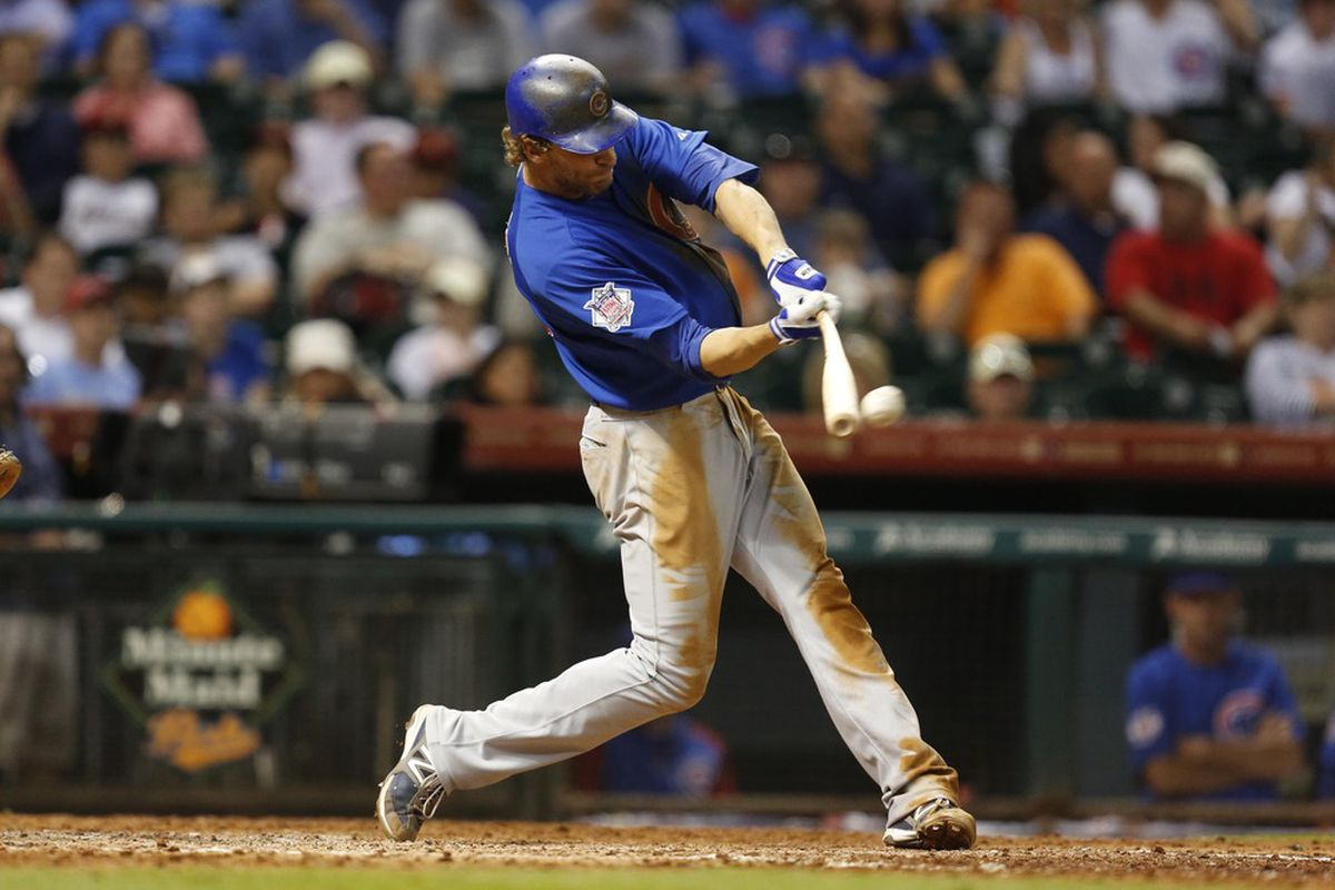 Houston, TX, USA; Chicago Cubs third baseman Joe Mather hits a single against the Houston Astros at Minute Maid Park. Credit: Thomas Campbell-US PRESSWIRE