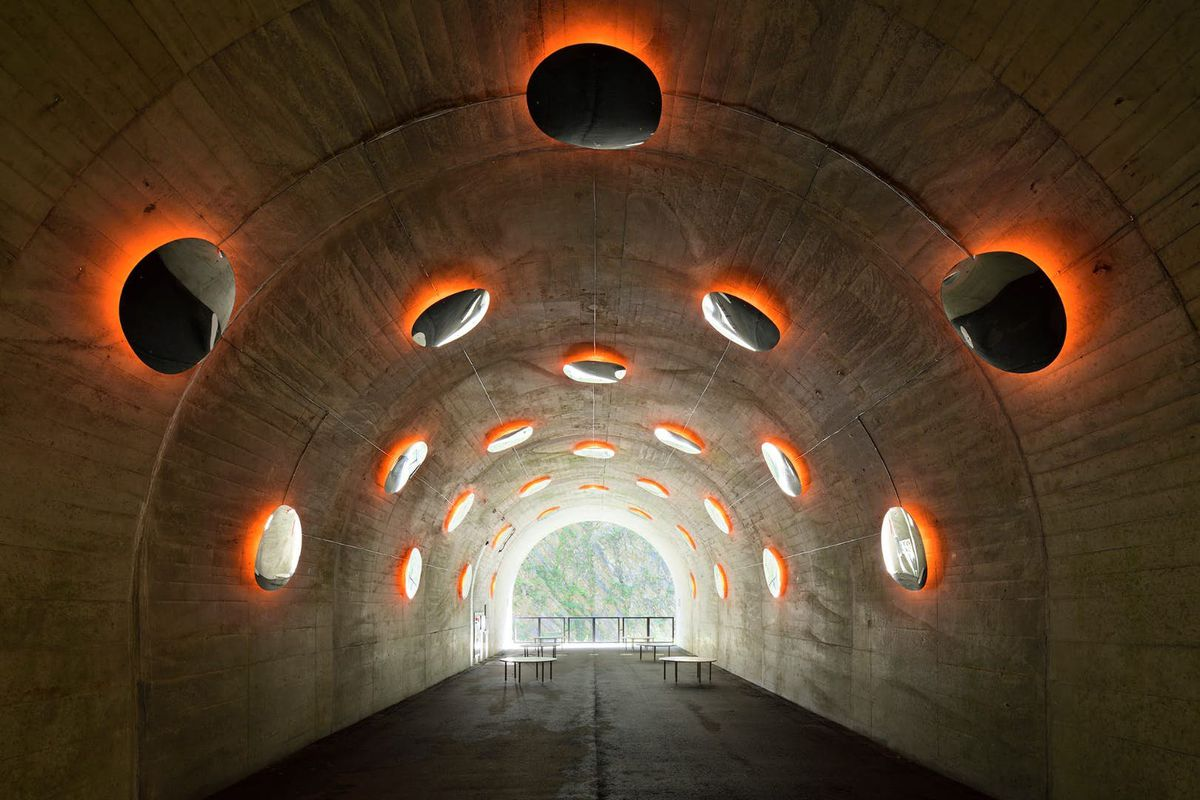 Tunnel with reflective mirrors and orange lights
