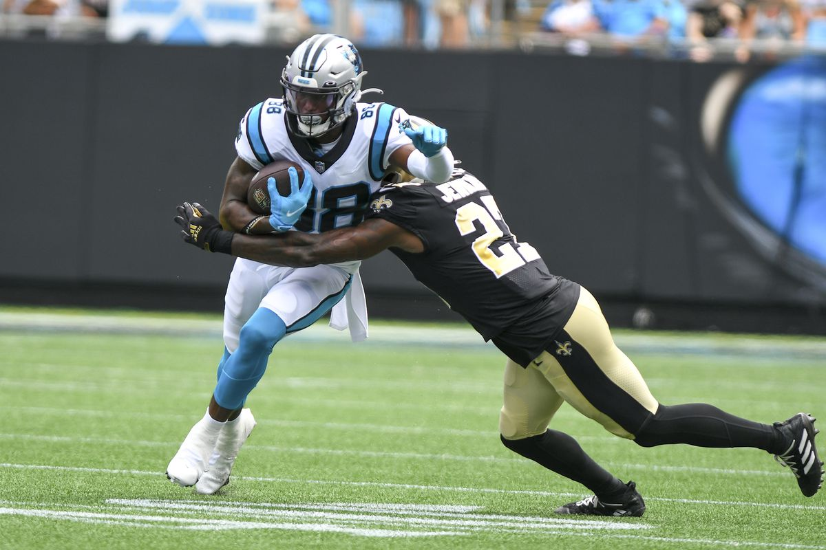 New Orleans Saints strong safety Malcolm Jenkins (27) comes in for the hit on Carolina Panthers wide receiver Terrace Marshall Jr. (88) during the game between the New Orleans Saints and the Carolina Panthers on September 19, 2021 at Bank of America Stadium in Charlotte,NC.