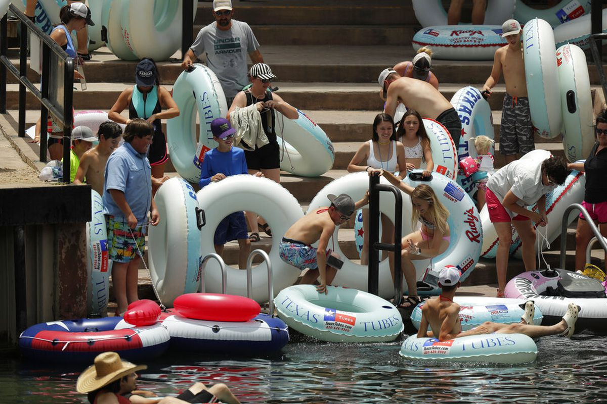 Tubers prepare to float the Comal River despite the recent spike in COVID-19 cases, Thursday, June 25, 2020, in New Braunfels, Texas.