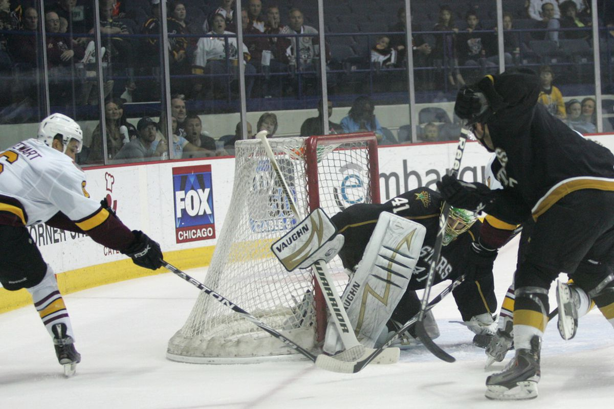 """Brent Krahn stops an Anthony Stewart scoring attempt in Game 2 of the Stars division final series (Photo Credit: <a href=""""http://ahlinphotos.blogspot.com/"""" target=""""new"""">Chris Jerina</a>)"""