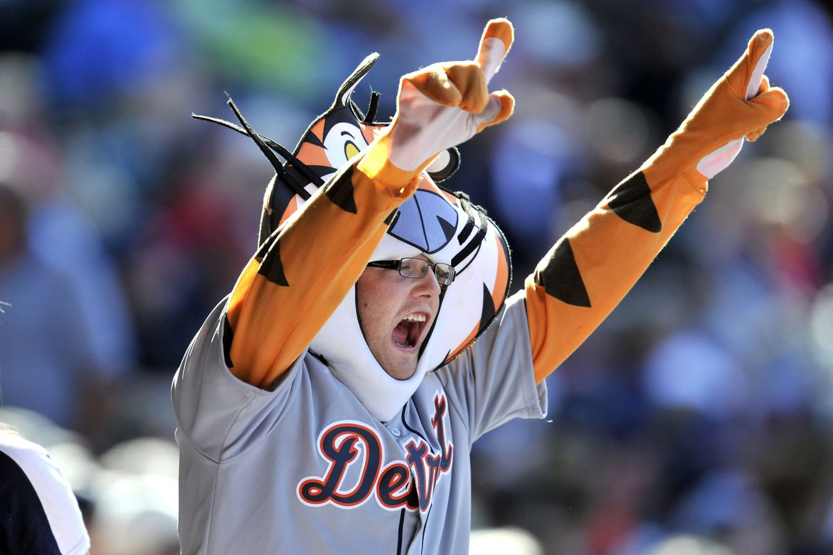 Sep 16, 2012; Cleveland, OH, USA; Detroit Tigers fan cheers during a game against the Cleveland Indians at Progressive Field. Mandatory Credit: David Richard-US PRESSWIRE