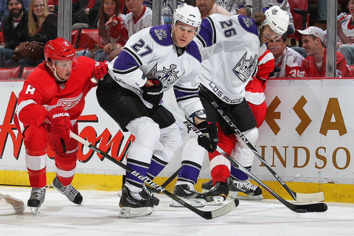 DETROIT, MI - MARCH 9:  Alexei Ponikarovsky #27 of the Los Angeles Kings eludes a check from Justin Abdelkader #8 of the Detroit Red Wings in a game on March 9, 2011 at the Joe Louis Arena in Detroit, Michigan. (Photo by Claus Andersen/Getty Images)