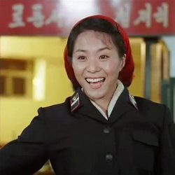 """FILE - In this file image made out of film """"Comrade Kim Goes Flying"""" released by Another Dimension of An Idea/Koryo Group, Comrade Kim Yong Mi played by Han Jong Sim acknowledges applause from her comrades for her acrobatic performance. An international film festival opens Thursday, Sept. 20, 2012 in the unlikeliest of places: North Korea. This year's festival includes movies from Britain, Germany and elsewhere. But not America. Festivalgoers will get to see two feature films in North Korea but edited overseas: the romantic comedy """"Comrade Kim Goes Flying,"""" a joint North Korean-European production, and """"Meet in Pyongyang,"""" made in conjunction with a Chinese film studio."""