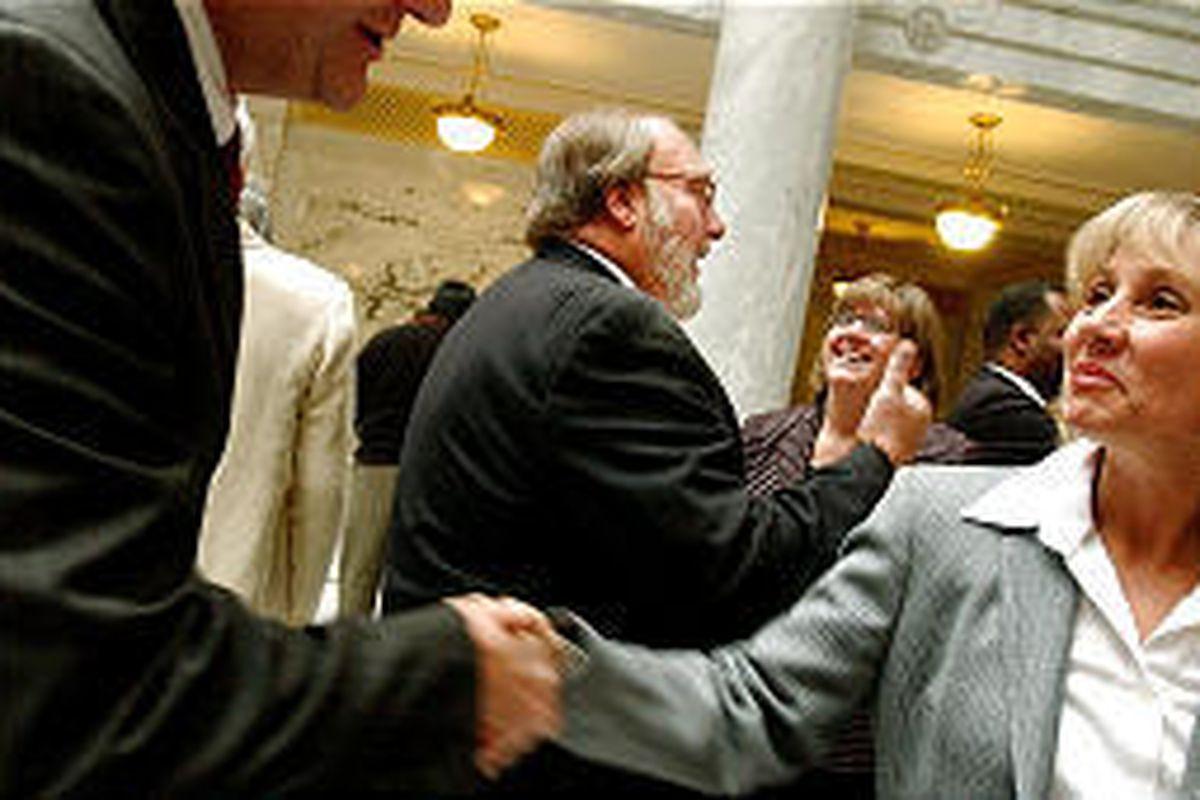 Sen. Ed Mayne, center and president of Utah AFL-CIO, speaks with Sen. Karen Hale while Rep. Karen Morgan, right, greets colleague.
