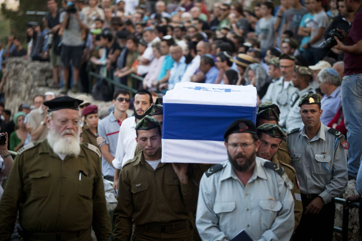 Israelis attend the funeral of a soldier killed in the Gaza fighting.