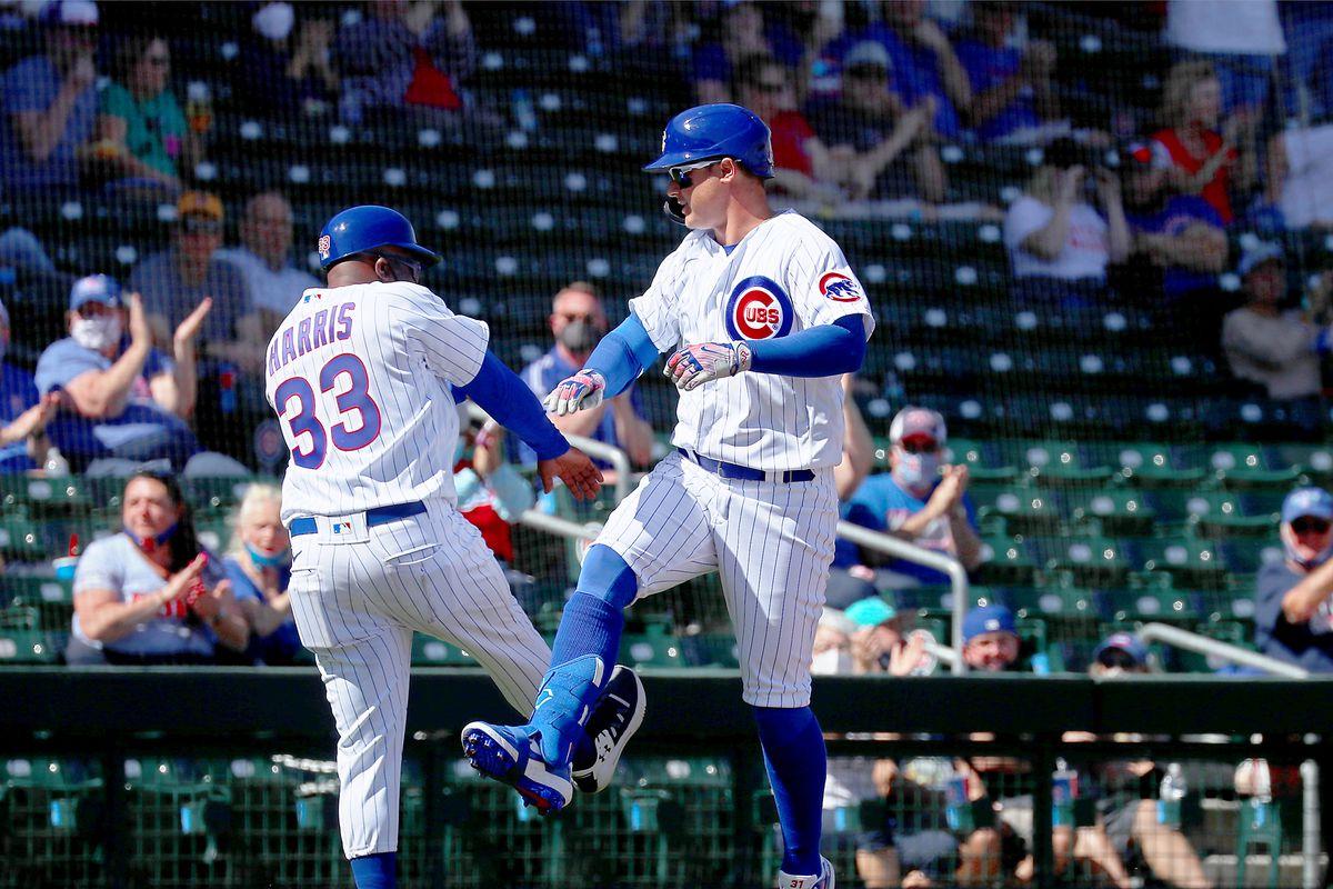 Joc Pederson celebrates a home run with Cubs third base coach Willie Harris.