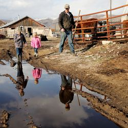 Addison Hicken walks with two of his kids Evan and Laynie and they work on the farm in Heber City on Wednesday, March 11, 2020.