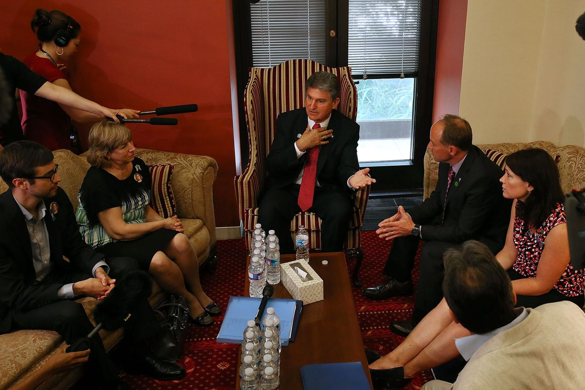 Sen. Joe Manchin (D-WV) meets with families of victims killed in the Sandy Hook shooting.