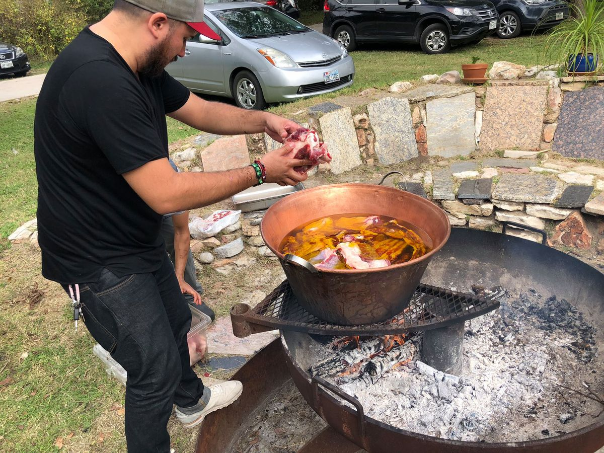 Suerte cooking at an event