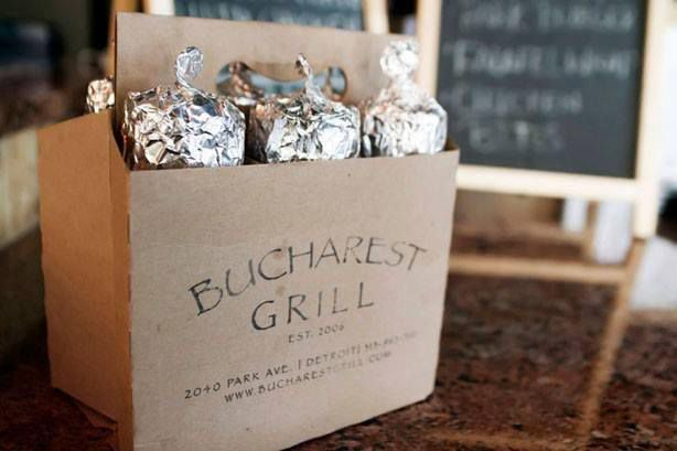 A box of Bucharest shawarma wrapped in tin foil to-go.