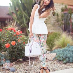"""Aimee of <a href=""""http://songofstyle.blogspot.com/"""">Song of Style</a> is wearing <a href=""""http://www.7forallmankind.com/pd/p/7665.html"""">7 For All Mankind</a> floral jeans, a Coach bag, a Whitney Eve top, Rachel Roy heels and Lionette and Vita Fede bracel"""