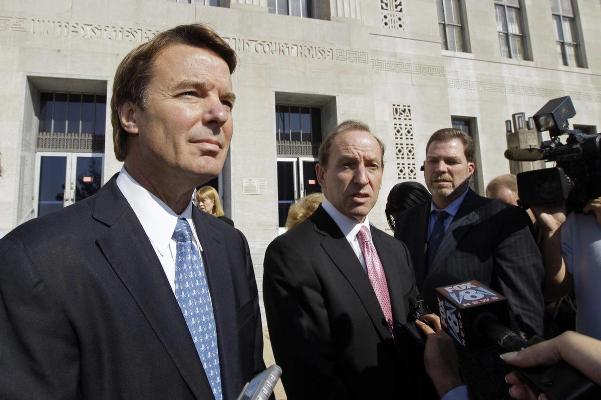 FILE - In an Oct. 27, 2011 file photo, former U.S. Sen. and presidential candidate John Edwards, left, speaks to the media with attorney Abbe Lowell, right, as he leaves the federal court in Greensboro, N.C.  Prosecutors and defense lawyers in the John Ed