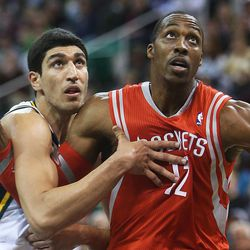 Utah Jazz's center Enes Kanter (0) works against Houston's Dwight Howard as the Jazz and the Rockets play Saturday, Nov. 2, 2013 in EnergySolutions arena.