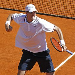 U.S. player John Isner reacts after winning his match against French player Jo-Wilfried Tsonga, in the quarterfinal of the Davis Cup between France and U.S. in Monaco Sunday April 8, 2012. The U.S. team qualifies for the semi-final. (AP Photo/Remy de la Mauviniere)