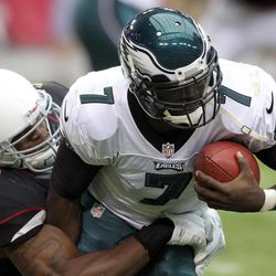 Philadelphia Eagles quarterback Michael Vick, right, is sacked by Arizona Cardinals linebacker Daryl Washington, left, in the second quarter of an NFL football game on Sunday, Sept. 23, 2012, in Glendale, Ariz.
