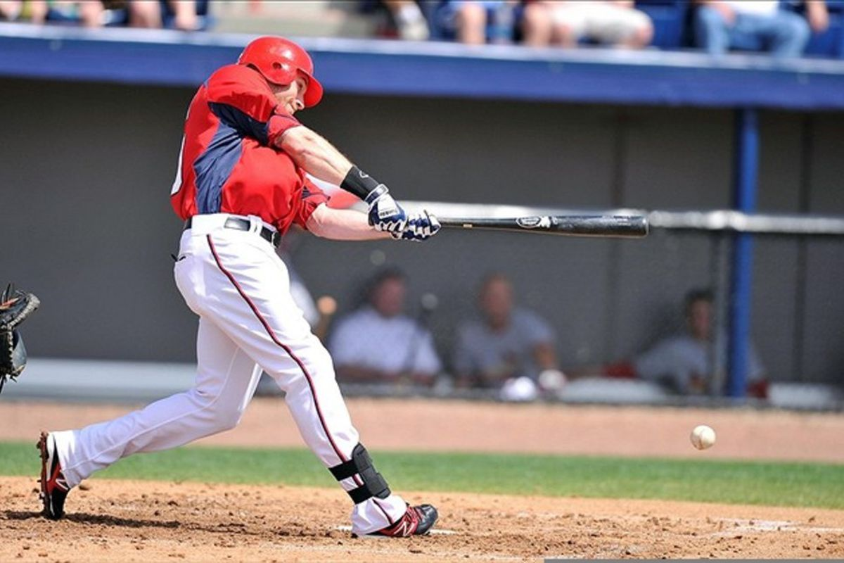 March 12, 2012; Melbourne, FL, USA;   Washington Nationals left fielder Corey Brown hits the ball in the second inning of the spring training game against the St. Louis Cardinals  at Space Coast Stadium. Mandatory Credit: Brad Barr-US PRESSWIRE