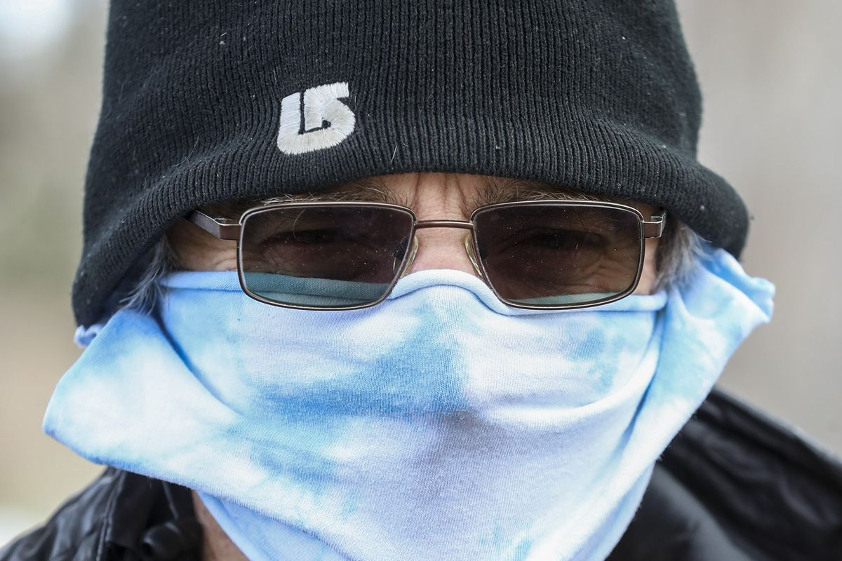 Peter Diamandis wears a mask as he walks in Liberty Park in Salt Lake City on Tuesday, April 14, 2020.