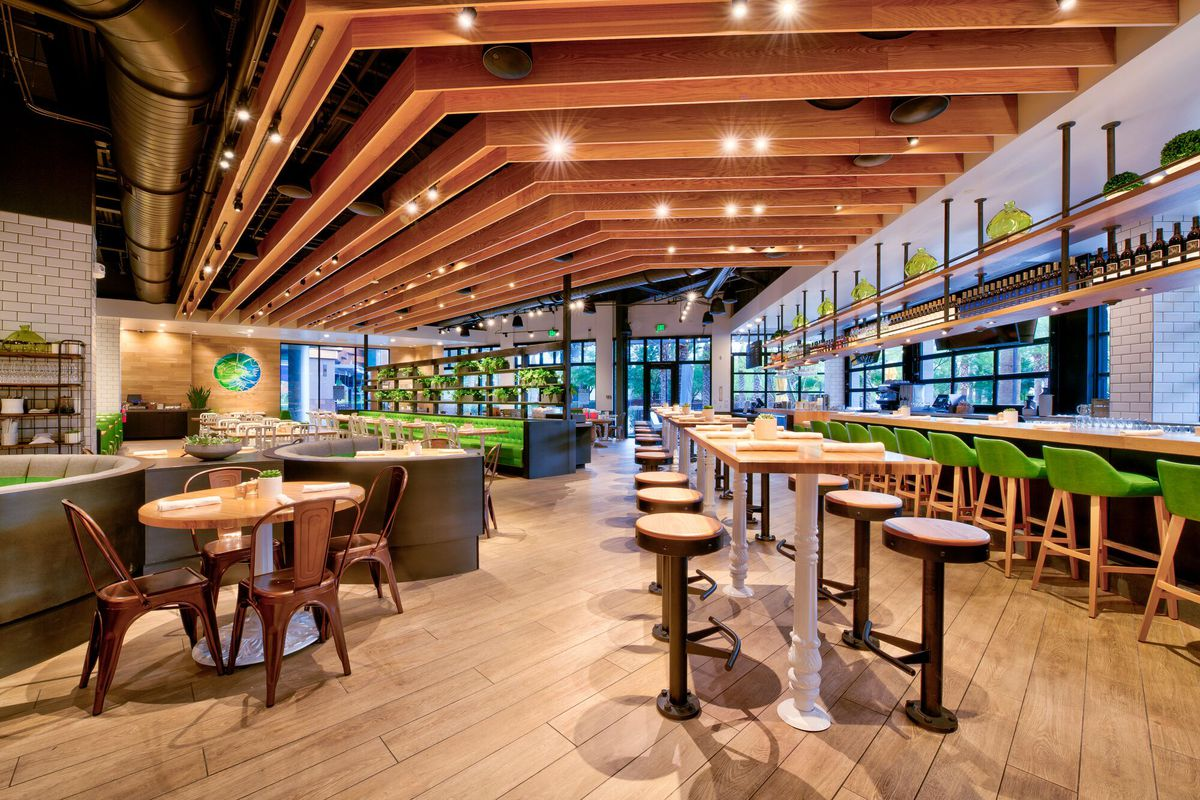 The True Food Kitchen seating choices, at the bar, in the casual space and the main dining area.