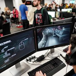 People try out games at EAE Play, the annual showcase for the Entertainment Arts and Engineering program, at the EAE Master Games Studio in Salt Lake City on Friday, Dec. 6, 2019.