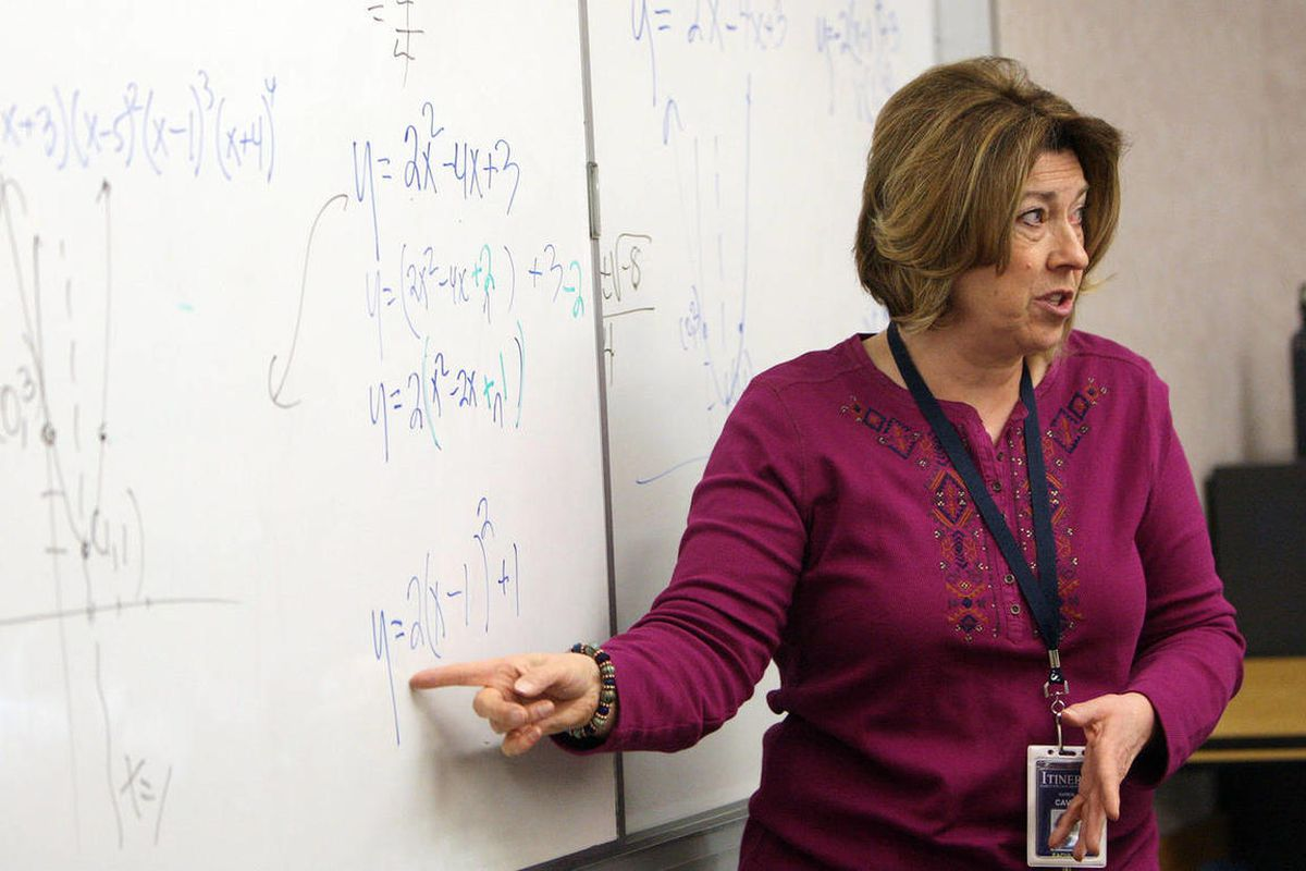 Itineris Early College High School teacher Karen Cavin teaches Math 1050 in West Jordan  Wednesday, Feb. 6, 2013.