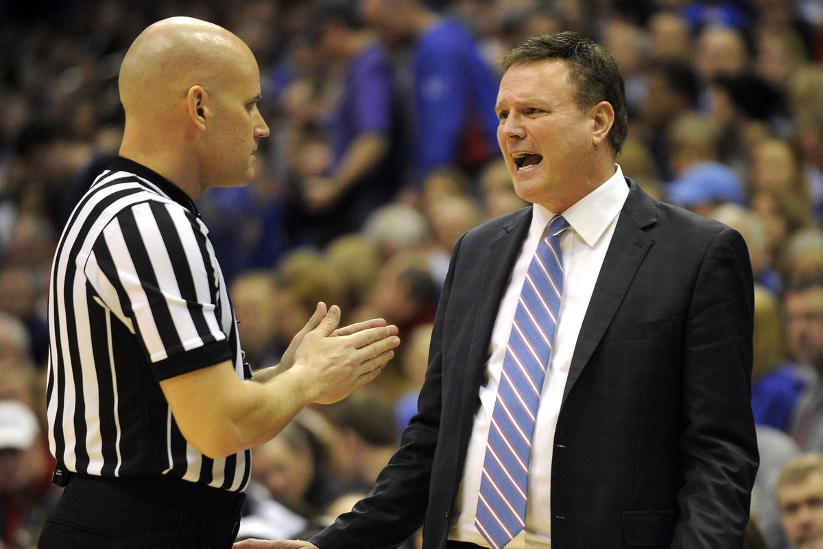 Bill Self (right) swears that he had no idea the check would bounce