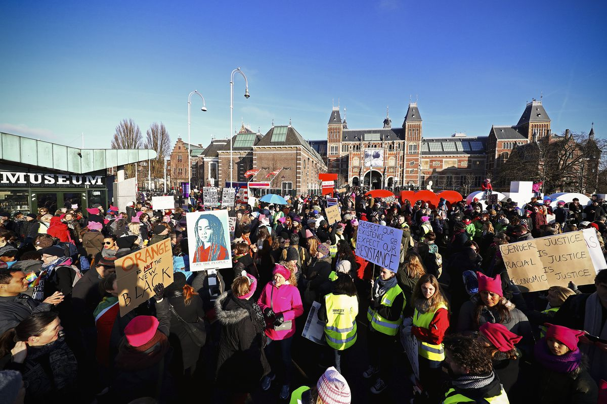 Demonstrators make their way from the iamsterdam statue in front of the Rijksmuseum towards US Consulate during the Women's March held at Museumplein on January 21, 2017 in Amsterdam, Netherlands.