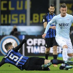 Sergej Milinkovic Savic of SS Lazio compete for the ball with Roberto Gagliardini of FC Internazionale during the serie A match between FC Internazionale and SS Lazio at Stadio Giuseppe Meazza on December 30, 2017 in Milan, Italy.