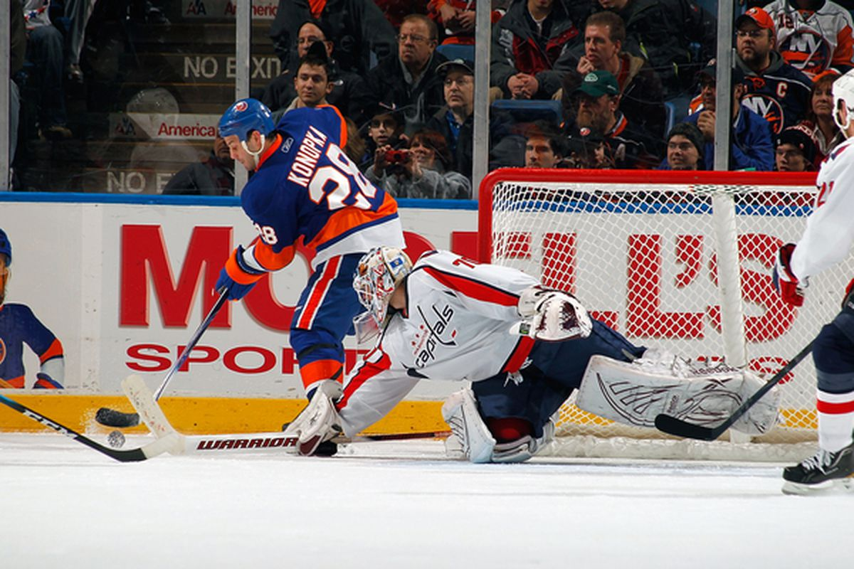 UNIONDALE NY - JANUARY 20:  Braden Holtby #70 of the Washington Capitals makes a save against Zenon Konopka #28 of the New York Islanders on January 20 2011 at Nassau Coliseum in Uniondale New York.  (Photo by Lou Capozzola/Getty Images)