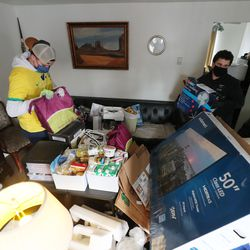 Elders Tanner Tripp and Nathaniel Thiriot from The Church of Jesus Christ of Latter-day Saints help Douglas and Pam Henderson move their belongings after being evicted from their apartment in South Salt Lake on Tuesday, Jan. 12, 2021.