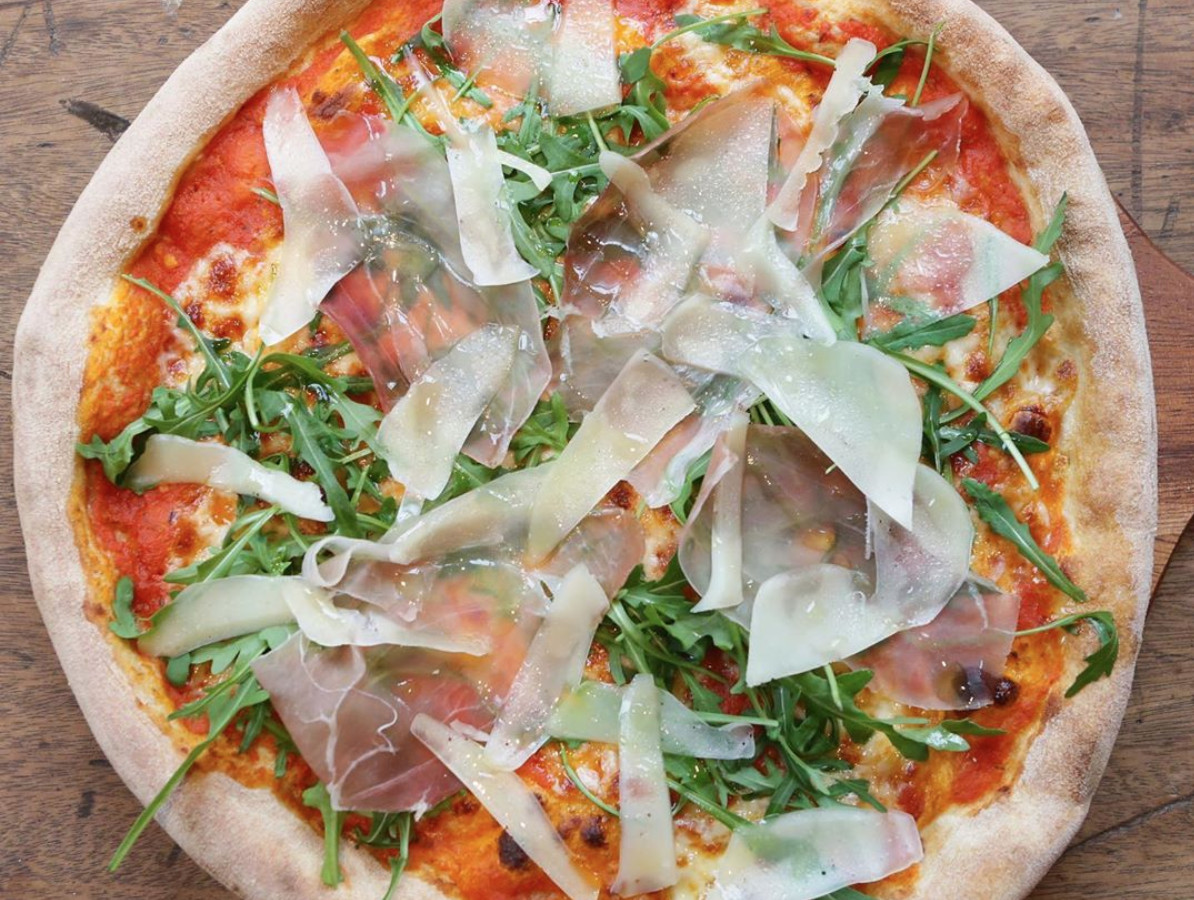 One of East Ham's best restaurants, Red Lion E6 servs this ham and parmesan pizza