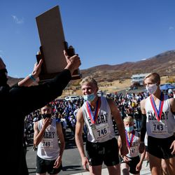 Emery runners collect their trophy after taking the team title in the 3A boys state cross-country championships at Soldier Hollow in Midway on Thursday, Oct. 22, 2020.