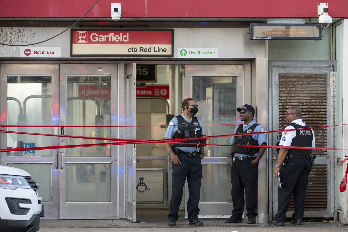Chicago police work the scene where a person was shot and killed on a Red Line train in the 200 block of W. Garfield Blvd. in the Englewood neighborhood, Monday, Aug. 19, 2021.