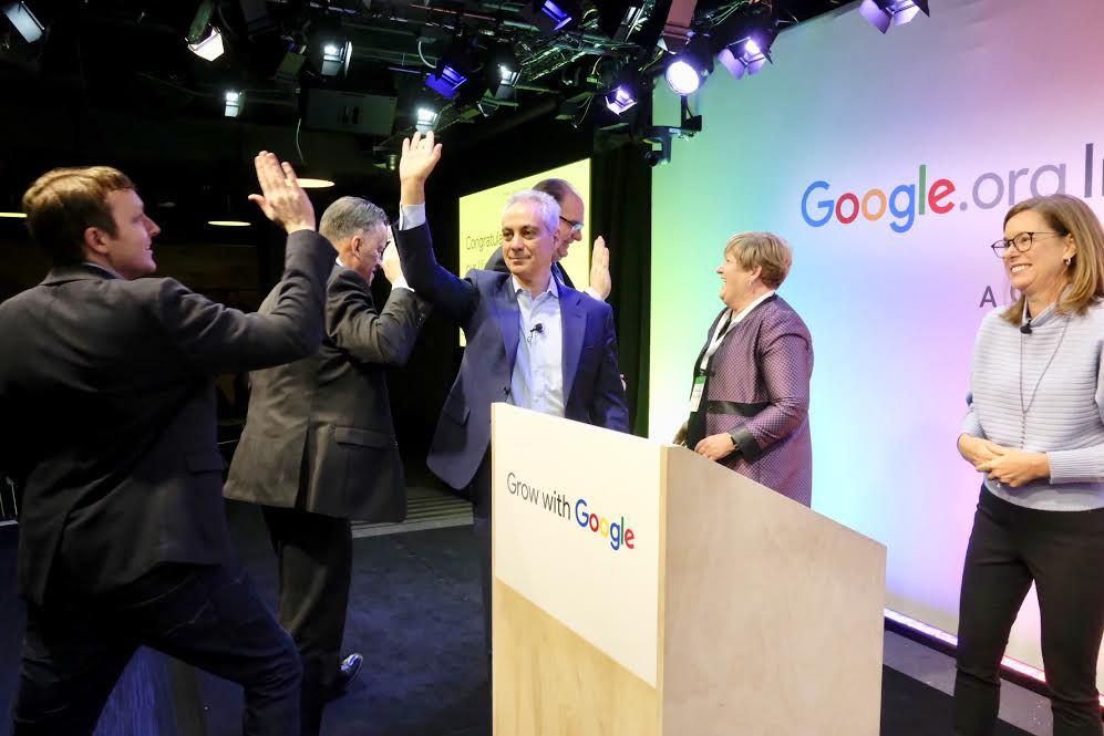Blake Pierce, with Mattoon In Motion, high-fives Mayor Rahm Emanuel, as the Downstate community development group was announced winner of a $250,000 bonus in Google's Impact Challenge Illinois. Google site leader Karen Sauder (far right) also announced th