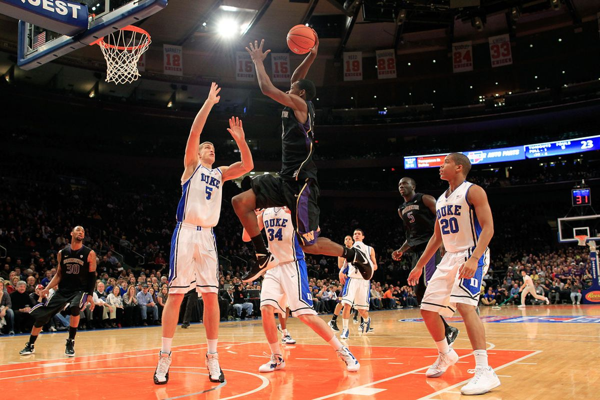 NEW YORK, NY - DECEMBER 10: Terrence Ross #31 of the Washington Huskies shoots over Mason Plumlee #5 of the Duke Blue Devils  at Madison Square Garden on December 10, 2011 in New York City.  (Photo by Chris Trotman/Getty Images)