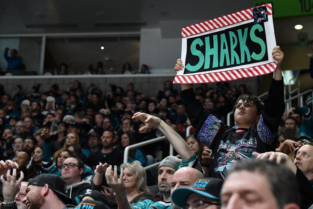 SAN JOSE, CA - DECEMBER 22: A fan raises a sign during the San Jose Sharks vs Vegas Golden Knights game at SAP Center on December 22, 2019 in San Jose, California.