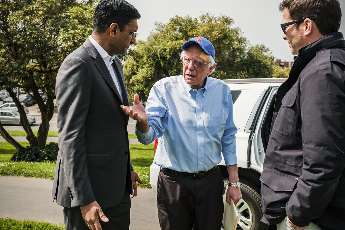 Congressman Ro Khanna (D-CA) speaks with Democratic Presidential candidate Sen. Bernie Sanders (D-VT) back stage before a Sanders rally in San Francisco, California, on March 24, 2019.