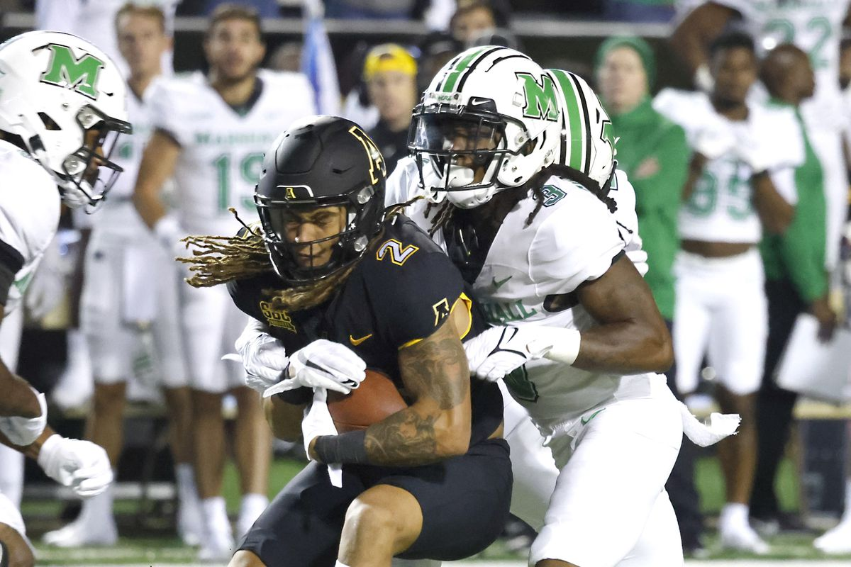 Marshall Thundering Herd defensive back Steven Gilmore tackles Appalachian State Mountaineers wide receiver Corey Xavier Sutton during the second quarter at Kidd Brewer Stadium.