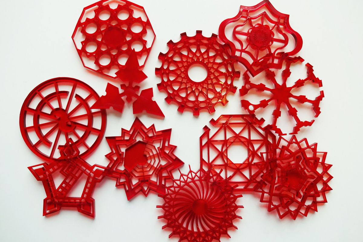 Array of red plastic snowflakes in various shapes.