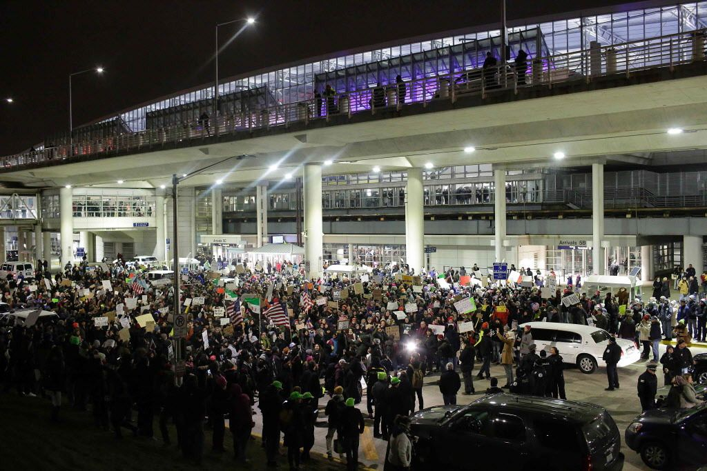 Demonstrators protest agaist President Trump's executive immigration ban at Chicago O'Hare International Airport on January 28. |  Joshua Lott/AFP/Getty Images
